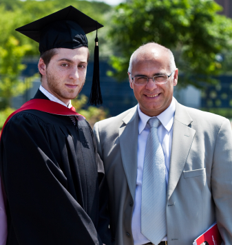 FutureSkills High School's alumni graduating from university with his happy father. یکی از دانش آموزان موفق ِ Dabirestan FutureSkills درجشن فارغ التحصیلی